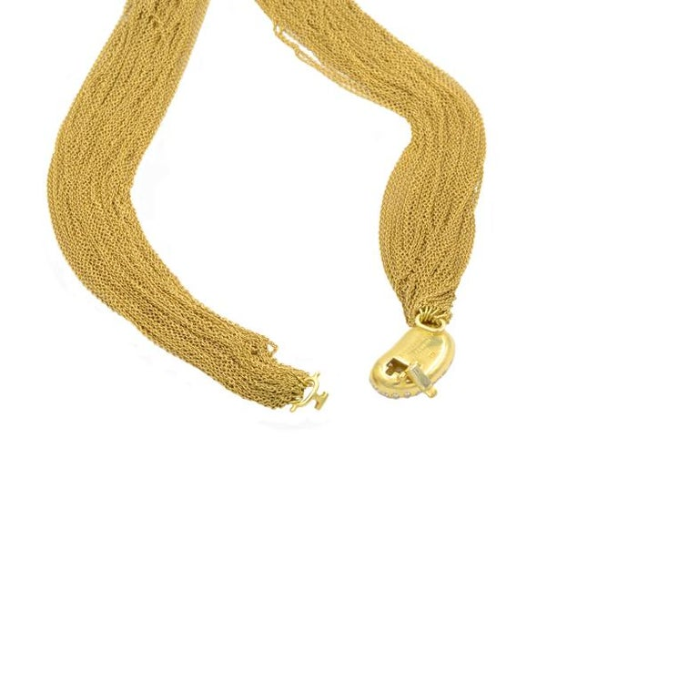 Tiffany Paloma Picasso diamond bean on a multi chain necklace of 18 karat yellow gold. Set with approximately 2 carats of beautiful round brilliant cut diamonds.  Circa 1990.  15 inches around.