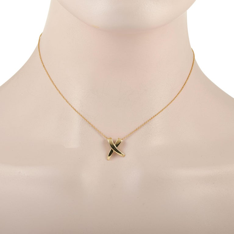 For the young and the young-at-heart, here is a Tiffany & Co. Paloma Picasso X Graffiti 18K Yellow Gold Pendant that's elegant and artsy. The pendant is an