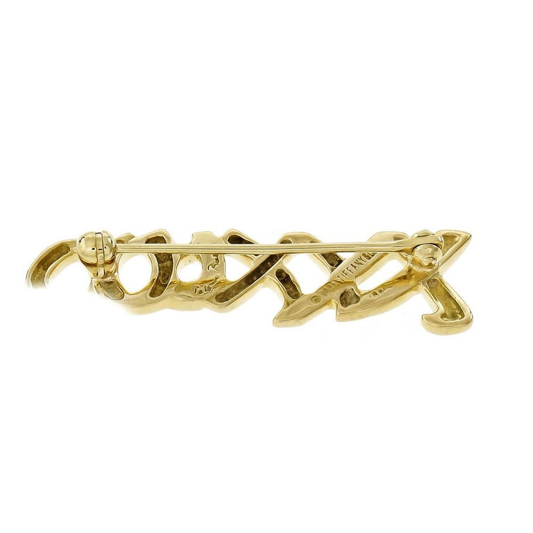 """Tiffany & Co Paloma Picasso signature """"XO"""" 18k yellow gold brooch.  18k yellow gold Tested: 18k Hallmark: Paloma Picasso Tiffany & Co © 1993 5.0 grams Top to bottom: 10.25mm or .40 inch Width: 36.04mm or 1.42 inches Depth: 2.04mm"""