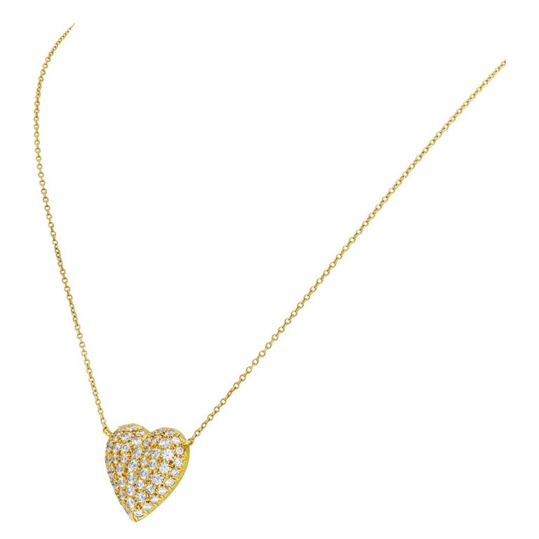 ESTIMATED RETAIL $15,000.00 - YOUR PRICE $7,900.00 - Tiffany & Co. pave diamond heart necklace in 18k, with approximately over 3 carats in F-G color, VVS-VS clarity round pave diamonds. Length 17 inches. Heart pendant dimensions: 0.75 inches by 0.75