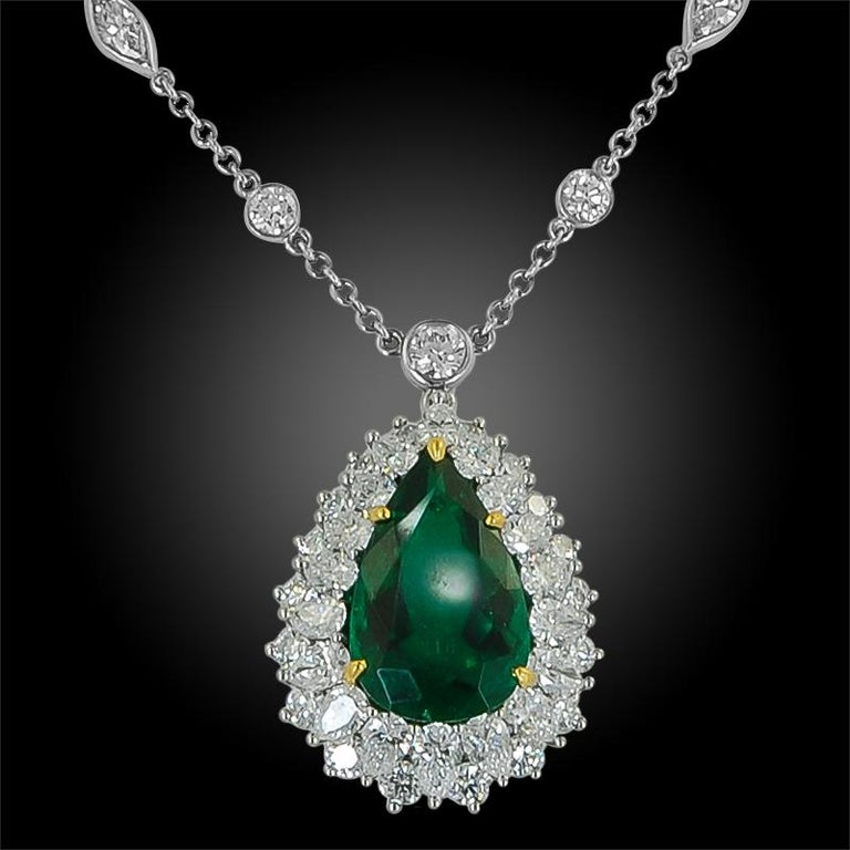 Platinum pear-shaped Colombian Emerald and diamond pendant/necklace, signed by Tiffany & Co. emerald - approx. 7.04 cts. with AGL certificate chain total length is approx. 18