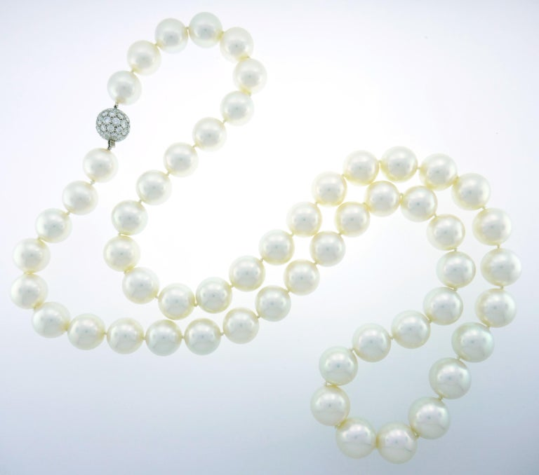 Stunning opera length South Sea pearl strand necklace with a diamond pave clasp created by Tiffany & Co. in 2005. Versatile, classy and timeless! The size and perfect matching of fifty-five pearls graduating from 17.2 mm to 15.2 mm are breathtaking!
