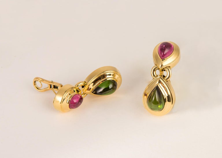 This is simply a classic. Tiffany & Co. combines soft pink and rich green tourmaline and sets them in wide elegant gold frames. This is a day to evening earring. 1 3/4 inches in length.