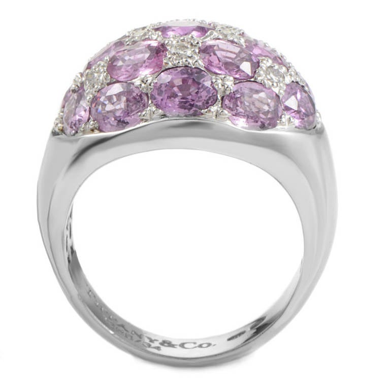 Luxurious and feminine, this ring from Tiffany & Co. is sure to be treasured for many years to come. The ring is made of 18K white gold and features a glittering white diamond and pink tourmaline pave.  Ring Size: 7.75 (55 7/8) Diamond Carat Weight: