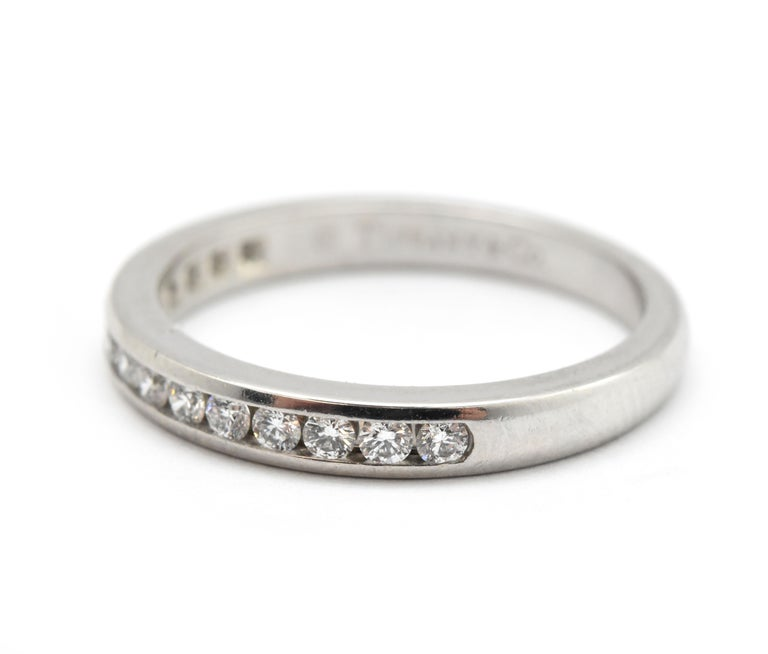 This is an authentic eternity band from Tiffany & Co. This ring is designed in platinum, and set with 15 diamonds to reach a total carat weight of 0.30cttw. This ring is F-G in color, and VS in clarity. This ring is stamped Tiffany & Co. and also
