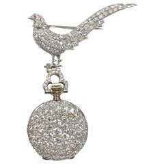 Tiffany & Co. Platinum and Diamond Encrusted Bird Form Lapel Pin and Watch