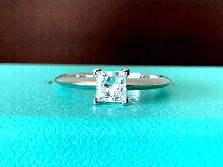For your consideration is a BRAND NEW Tiffany & Co Princess cut .57 carat natural diamond solitaire.  This stunning ring was purchased for an engagement that never happened - the ring is absolutely BRAND NEW with no marks, nicks or scratches - it