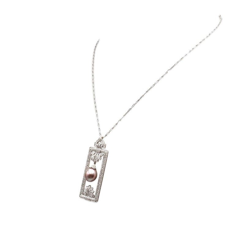 Authentic Tiffany & Co. diamond pearl pendant crafted in platinum. A 10mm Tahitian pearl with a silver body color and an aubergine overtone hangs in an elaborate frame that is pave set with an estimated 4.25 cts of round brilliant diamonds (G-H