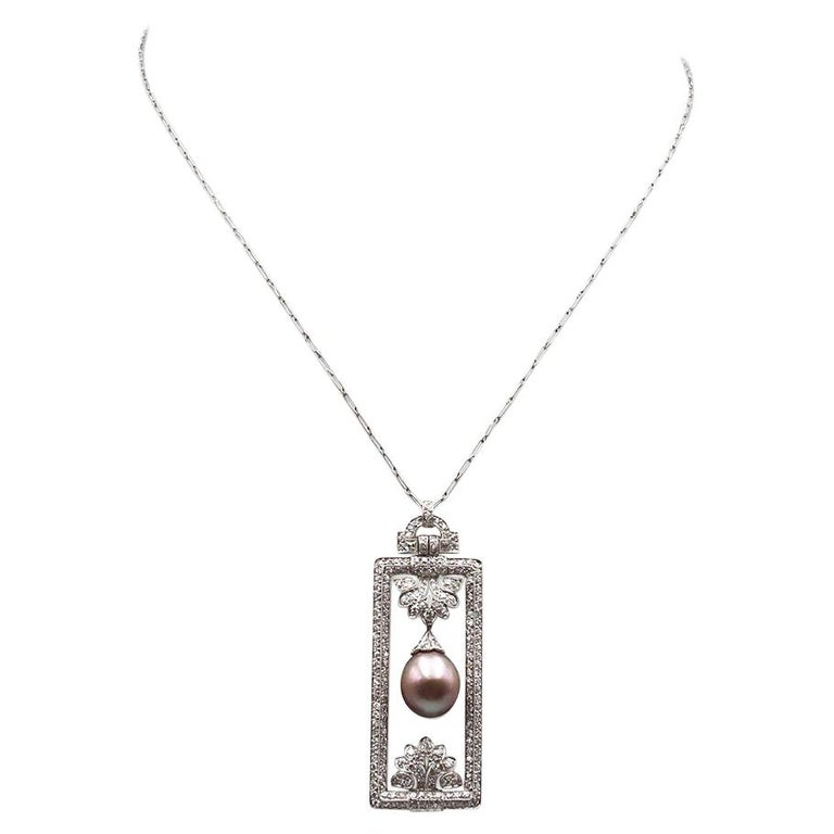 Tiffany & Co. Platinum Diamond and Pearl Pendant For Sale