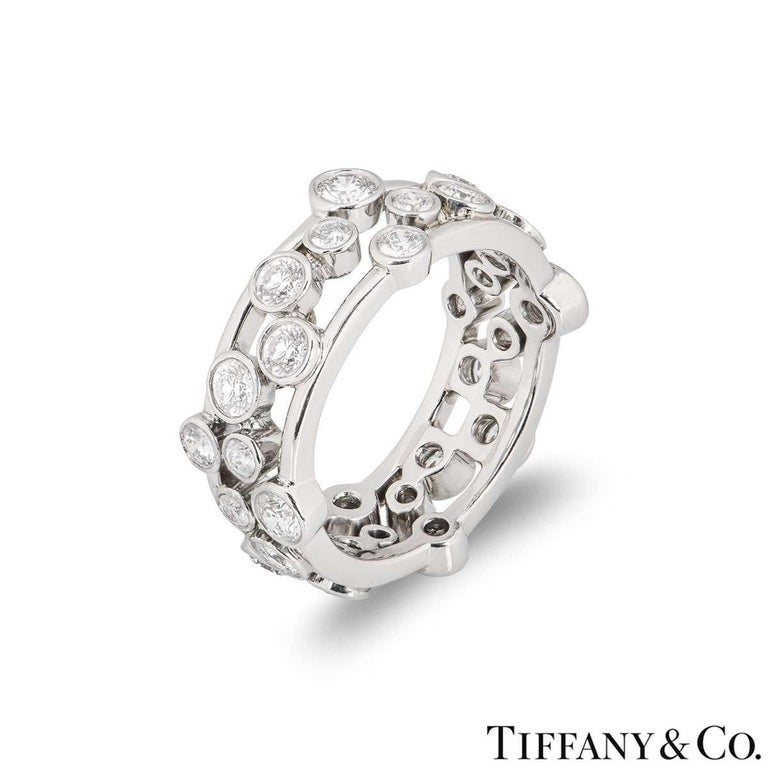 A platinum diamond ring from the Bubble collection by Tiffany & Co. The ring is set with round brilliant cut rubover set diamonds varying in size. The diamonds have an approximate total weight of 1.60ct. The ring measures 8mm in width and is a size