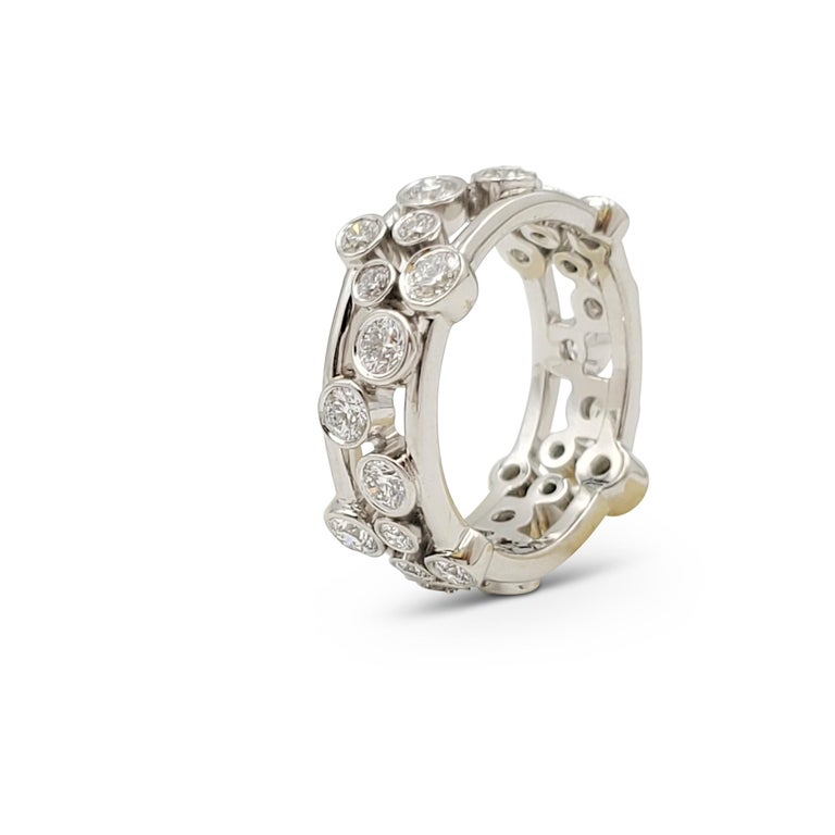 Authentic Tiffany & Co. ring from the 'Bubbles' collection is crafted in platinum and bezel set with various sized round brilliant cut diamonds (E-F. VS) weighing an estimated 1.60 carats total weight. Signed  T&Co., PT 950. Ring size 6. The ring is