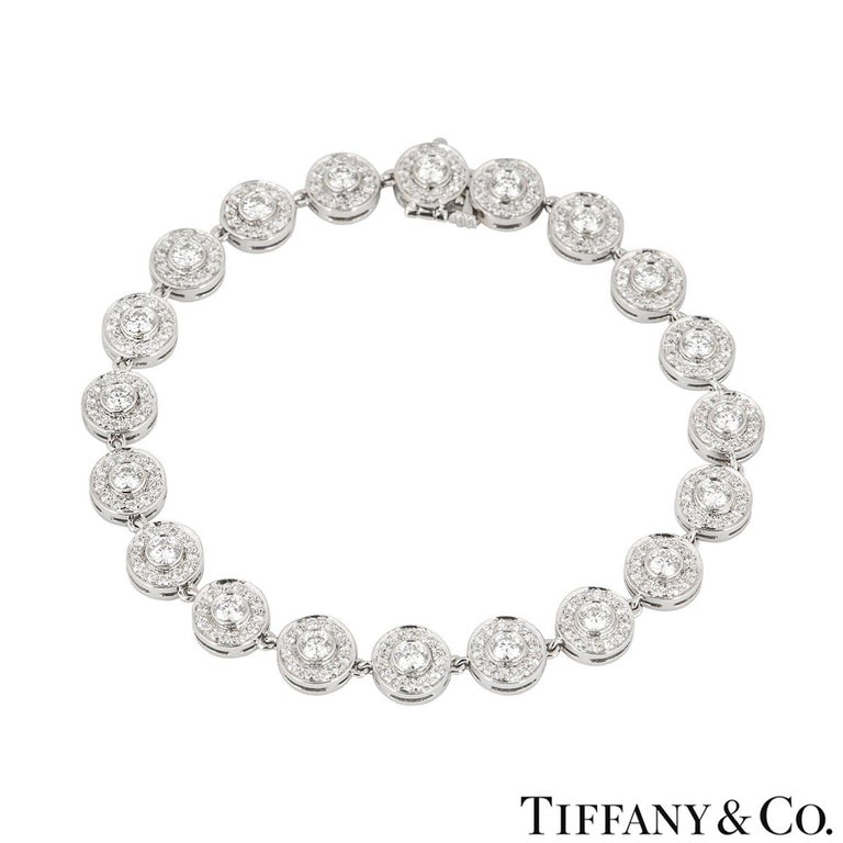 A platinum diamond bracelet by Tiffany & Co. from the Circlet collection. The bracelet features 20 circular motifs set with a single round brilliant cut diamond in the centre and surrounded by pave round brilliant cut diamonds.  The 260 diamonds