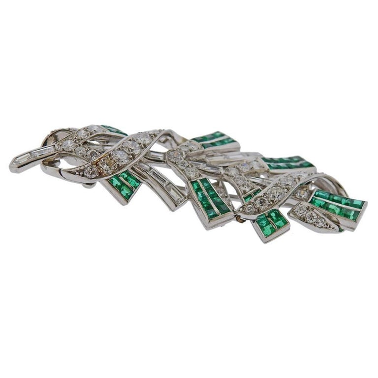 Platinum Tiffany & Co brooch with emeralds and diamonds approx. 2.50-2.80ctw in diamonds. Measures - 55mm x 22mm. Weights 16.1 grams. Marked Tiffany & Co Irid Plat.