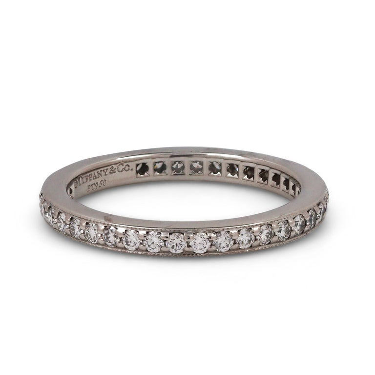 Authentic Tiffany & Co. eternity band crafted in platinum and channel set with an estimated 0.40 carats of high-quality round brilliant diamonds. US size 5 1/2. Signed Tiffany & Co., PT950. Ring is not presented with the original box or papers.