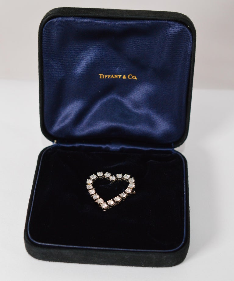 Please your sweetheart with this brilliant vintage Tiffany & Company .900 platinum heart-shaped brooch displaying eighteen G/VS round fine white cut diamonds. Diamonds weight estimated 2.50 carat total weight. The brooch measures 27 mm x 26.79 mm