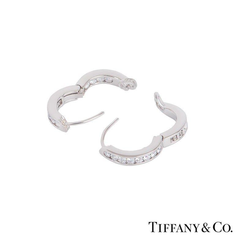 A beautiful pair of platinum diamond hoop earrings by Tiffany & Co. The earrings feature 12 round brilliant cut diamonds set on the outside and inside of the earrings in a channel setting with an approximate total weight of 0.72ct. The earrings