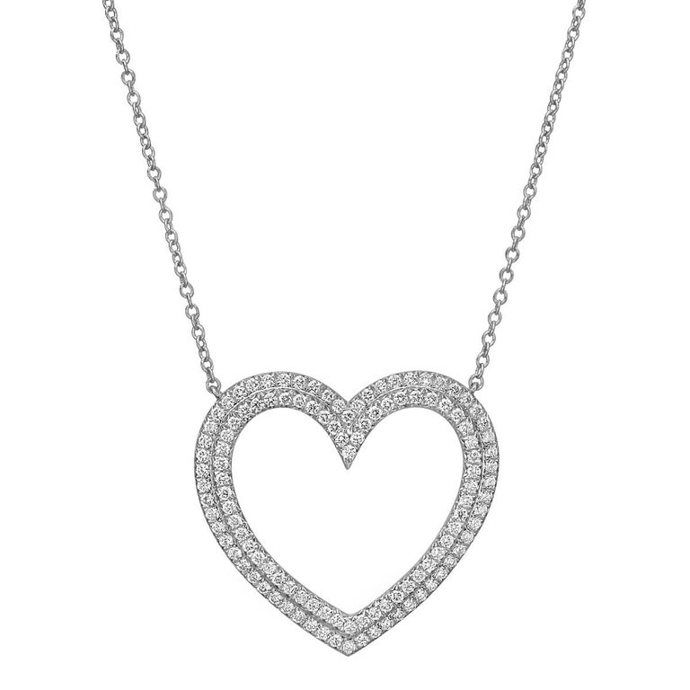 Open heart pendant, set with a double row of round brilliant-cut diamonds in platinum, on the matching 16.75