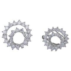 Tiffany & Co. Platinum Diamond Swirl Brooches, Set
