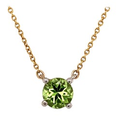 Tiffany & Co. Platinum, Gold and Peridot Solitaire Pendant