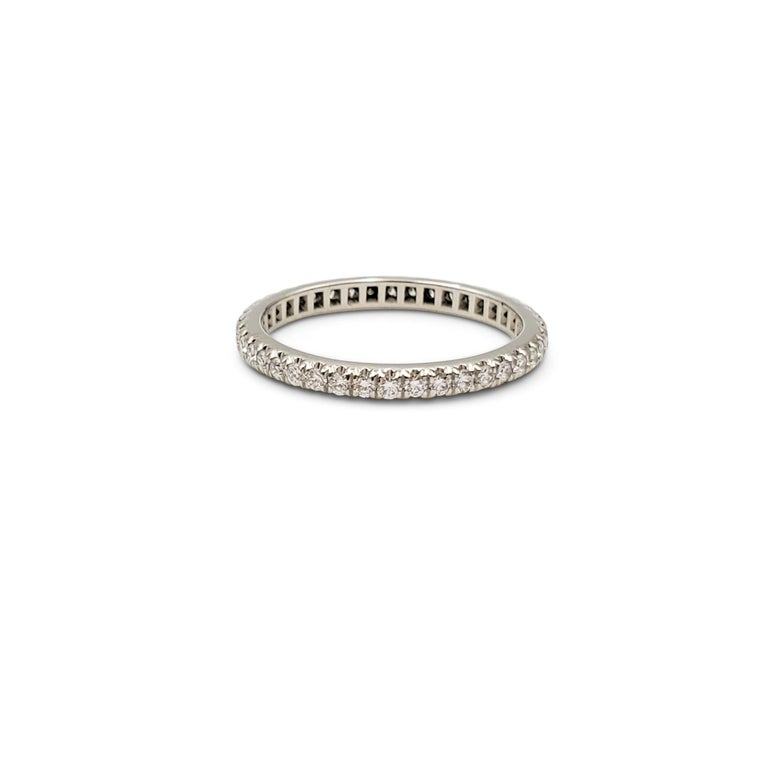 Authentic Tiffany & Co. eternity band crafted in platinum and pavé set with an estimated 0.40 carats of round brilliant cut diamonds (E-F, VS). Signed Tiffany & Co., PT950. Ring size US 5. The ring is not presented with the original box or papers.