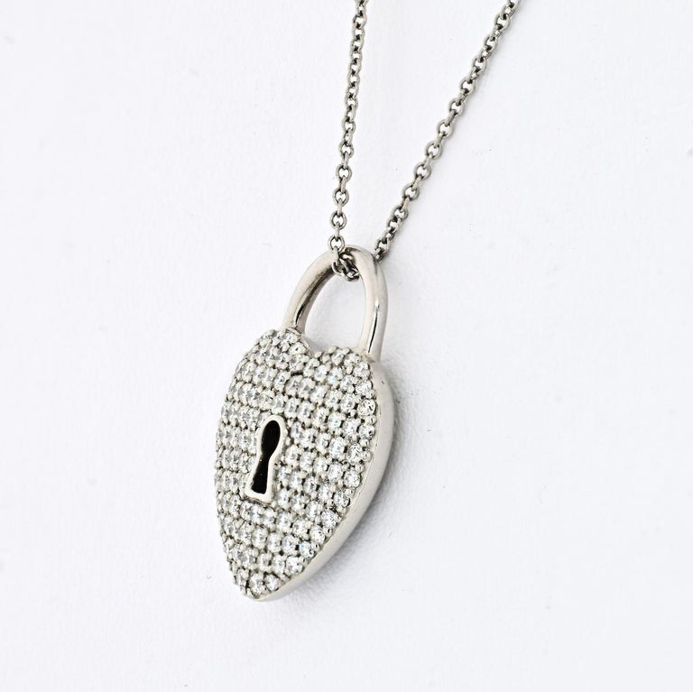 A stunning diamond heart pendant from the Tiffany Locks collection by Tiffany & Co. Set in platinum the pendant is composed of a heart lock motif pave set with round brilliant cut diamonds totaling 0.76ct, predominately G+ color and VS+ in clarity.