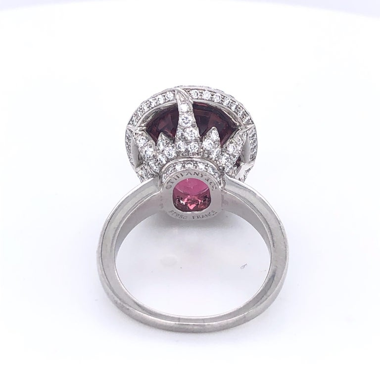 This beautiful Tiffany and Company Pink Tourmaline and Diamond Ring is sure to satisfy the pink lover!  In spectacular shape this ring sports a faceted 12 Carat Pink Tourmaline set in two carats of diamonds.  The back of the ring and it's intricate