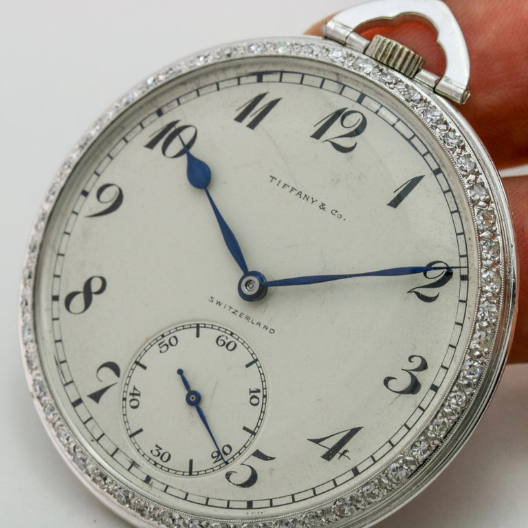 Gent's Tiffany & Co. platinum pocket watch with factory diamond bezel. The watch is powered by a Patek Philippe 18 jewels hand-winding movement. Circa 1930s.  Size, 18 Diameter, 45mm  The watch is in excellent condition and has been serviced by