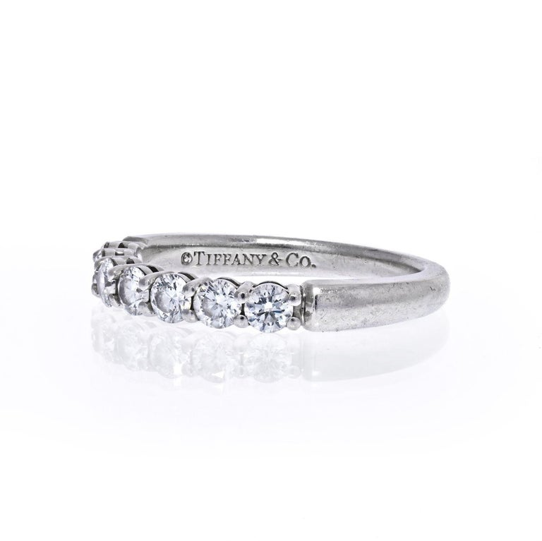Tiffany & Co shared prong seven diamond wedding band crafted in patinum. Size 6.  Approx. carat weight 0.45cttw.