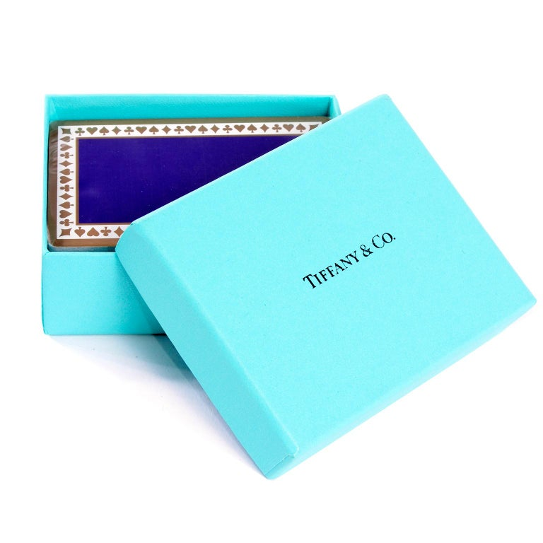 These Tiffany playing cards have never been used. and are still wrapped in their original plastic and in the Tiffany blue box. Cards are purple with gold detail around the edges. These cards would make a perfect gift for the card player in your