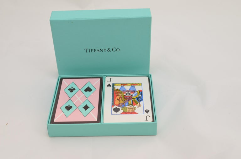 Tiffany & Co. Playing Cards Set -- Two sets of playing cards with a harlequin print in a signature Tiffany's blue box. Measures: 5 x 4 inches.
