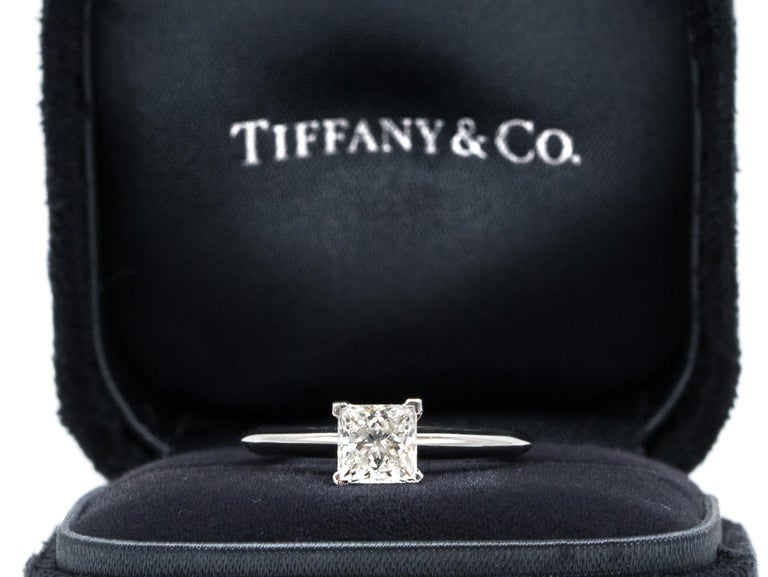 Tiffany & Co. Princess Diamond Engagement ring signed by Tiffany & Co. featuring a .88 ct Center, graded F color , and VVS2 Clarity, in Platinum.  Includes Original Tiffany Certificate,  and Box Approximate Retail from Tiffany & Co:  $10,000   Ring