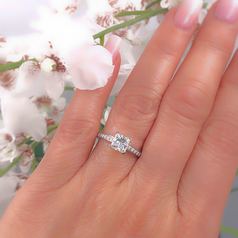 Tiffany & Co. Diamond Engagement Ring Style:  Tiffany Grace Serial Number:  # 33682646 Metal:  Platinum PT950 Size:  5.75 - Sizable Total Carat Weight:  1.29 tcw Diamond Shape:  Center Diamond - Princess Cut 1.09 cts H color, VVS1 clarity Accent