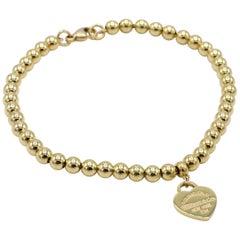 Tiffany & Co. Return to Tiffany 18 Karat Gold Mini Heart Tag Bead Bracelet
