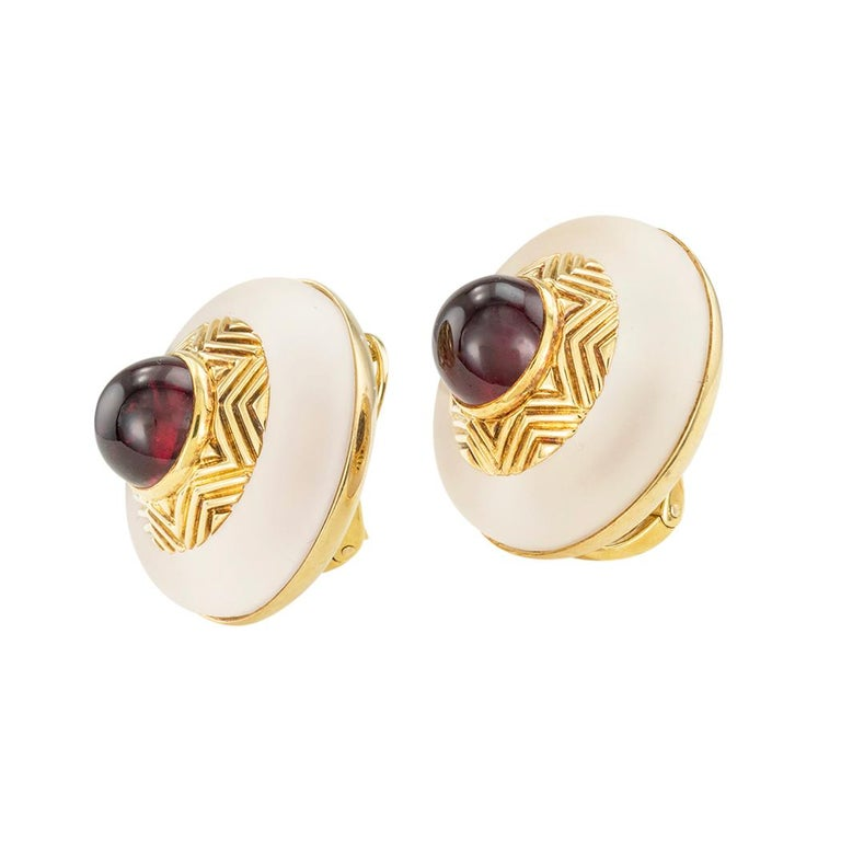 Tiffany & Co rock crystal garnet and gold clip-on earrings circa 1980.  Clear and concise information you want to know is listed below.  Contact us right away if you have additional questions.  We are here to connect you with beautiful and