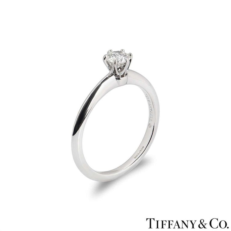 A beautiful platinum diamond ring by Tiffany & Co. from The Setting collection. The ring comprises of a round brilliant cut diamond in a 6 claw setting with a weight of 0.32ct, H colour and VVS1 clarity. The diamond scores an excellent rating in all
