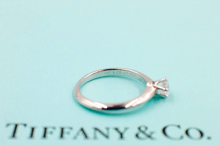 Tiffany & Co. Style:  Solitaire Engagement Ring Serial Number:  16428698 Metal:  Platinum PT950 Size:  4.25 - sizable  Total Carat Weight:  0.28 TCW Diamond Shape:  Round Brilliant Diamond 0.28 CTS Diamond Color & Clarity:  D / IF Hallmark: