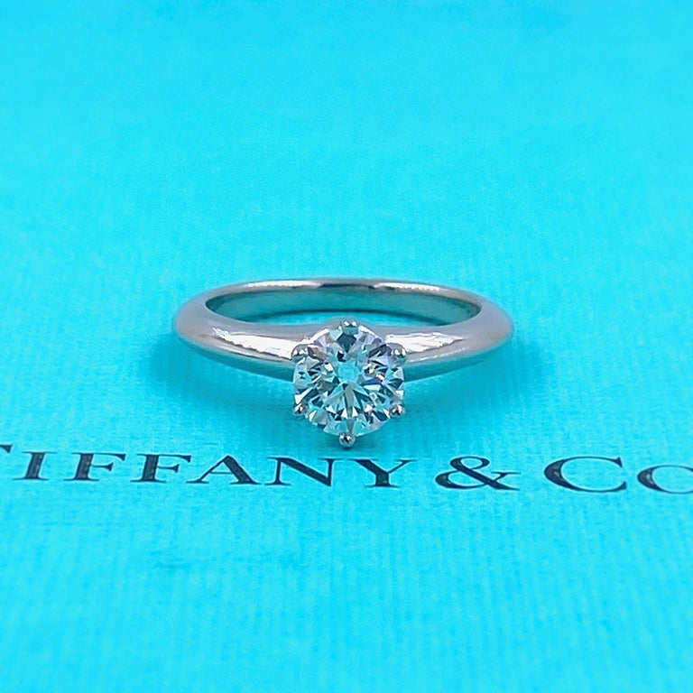 Tiffany & Co Solitaire Engagement Ring Style:  6-Prong Classic Solitaire Ref. number:  35469834/Q04060401 Metal:  Platinum PT950 Size:  4.5 sizable  Measurements:  5.77 - 5.80 X 3.59MM TCW:  0.74 cts Main Diamond:  Round Brilliant Diamond Color &