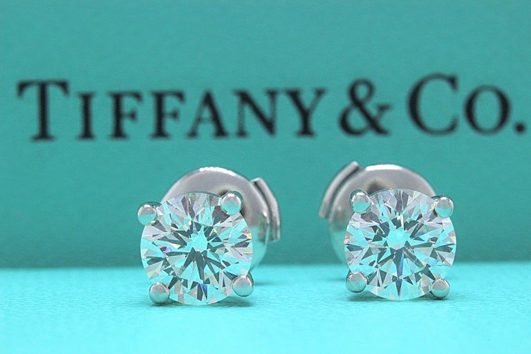 Tiffany & Co.  Style:  Diamond Srud Earrings Serial Number:  #18519771 Metal:  Platinum PT950 Backs:  Pousette for Pierced Ears Width:  7 MM Each Total Carat Weight:  2.04 TCW Diamond Shape:  Round Brilliant Diamond Color & Clarity:  1.02 CTS I VVS2