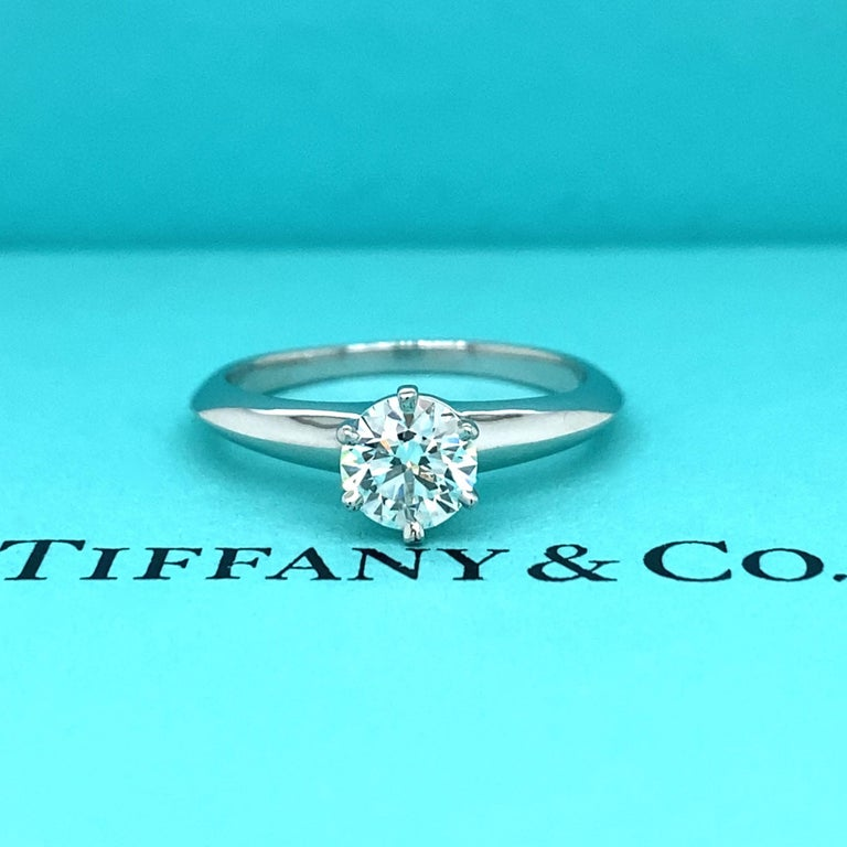 Tiffany & Co Solitaire Engagement Ring Style:  Classic 6-Prong  Ref. number:  18617595/E12230183 Metal:  Platinum PT950 Size:  6 sizable TCW:  0.60 cts Main Diamond:  Round Brilliant Cut Color & Clarity:  I / VVS1  Hallmark:  ©TIFFANY&CO. PT950