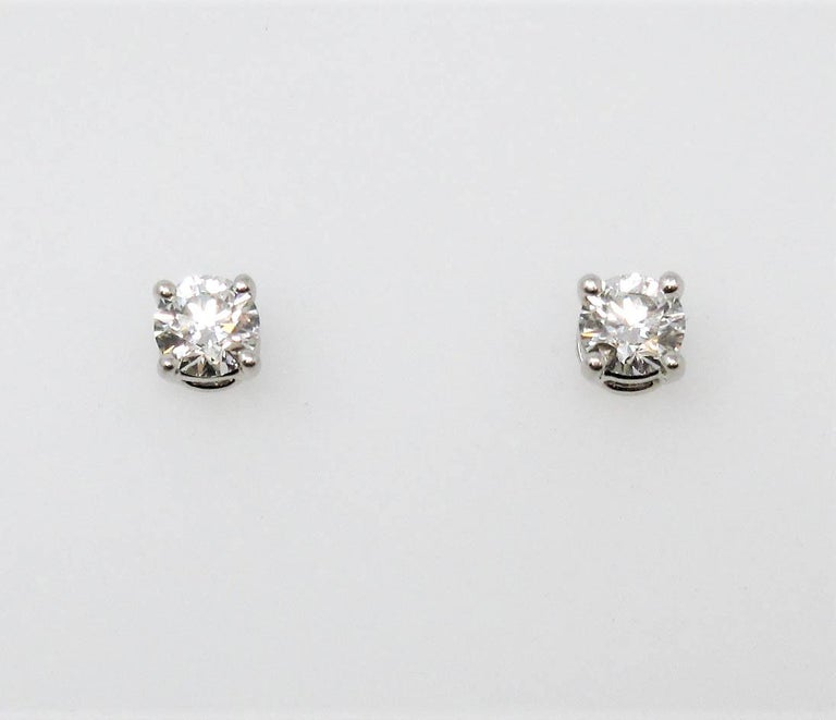 Round Cut Tiffany & Co. Round Solitaire Diamond Stud Earrings in Platinum F/VS1 .42 Carat For Sale