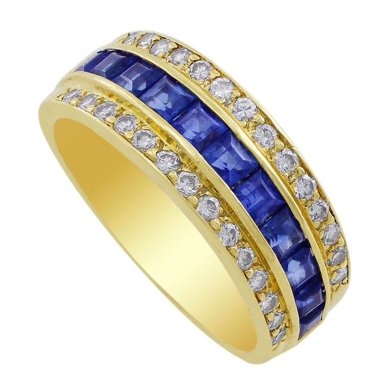 Tiffany & Co. Sapphire Diamond Ring. An 18k yellow gold Tiffany & Co. ring set with 11 princess cut sapphires and 28 round diamonds. The total sapphire weight is approximately 0.44cts and the total diamond weight is approximately 0.28cttw. The ring
