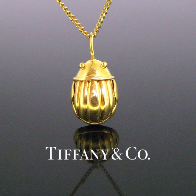 Weight:6.98gr   Metal:18k yellow gold    Signature:Tiffany&Co   Condition:Very Good   Comments: This lovely pendant depicts the iconic Scarab charm pendant made by Tiffany & Co in 1993. It is in 18k hollow yellow gold. The charm is signed and