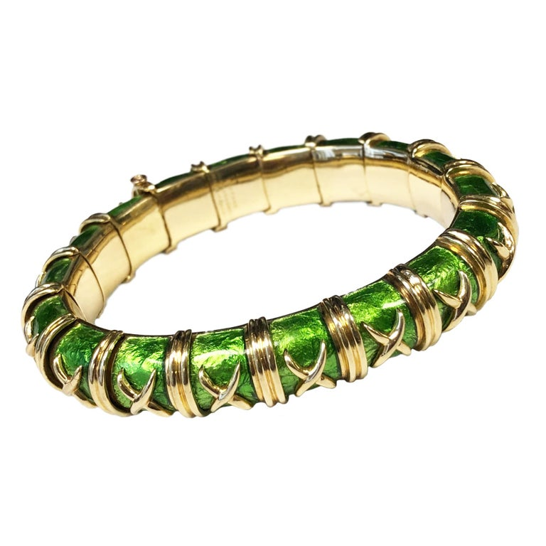 Circa 1990 Jean Schlumberger for Tiffany & Company, Croisillon Bracelet. 18 k Yellow Gold and Green Guilloche enamel. Each link is individually attached giving the bracelet a soft flexibility, measuring 5/8 inch wide and 6 1/2 inches in length.