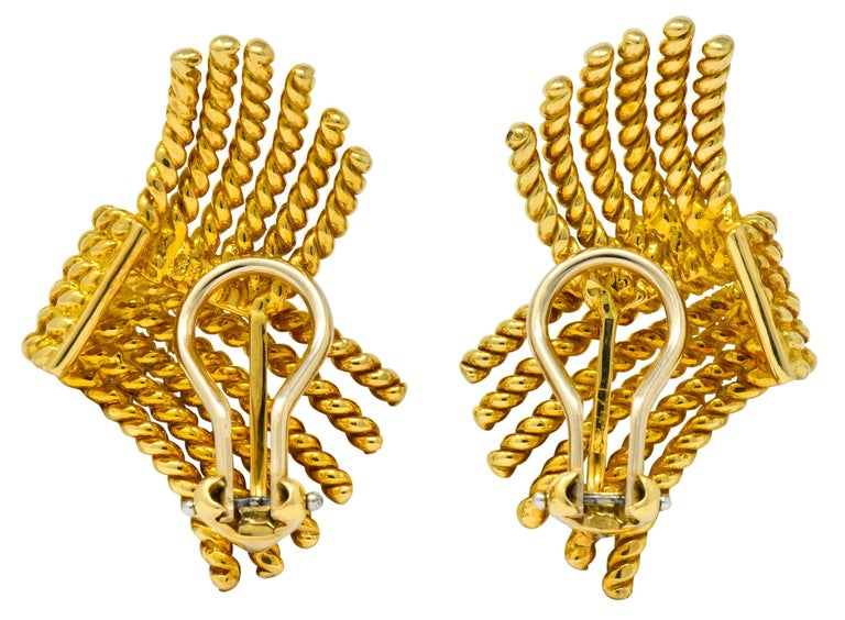 Twelve strands of twisted rope motif overlapped like fringed ends of a scarf  Completed by hinged omega clip-backs  Fully signed Tiffany & Co. Schlumberger  Stamped 18k for 18 karat gold  Measures: 1 1/4 x 3/4 inches  Total weight: 16.9 grams  Bold.