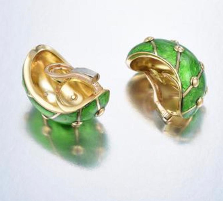 The Banana earrings represent an iconic Schlumberger design, crafted out of 18K yellow gold, with lime green enamel applied between four rows of raised gold beads; backs are clip-on; each earring measures 1 x 3/4 inches; weight 29.3 g; in box with
