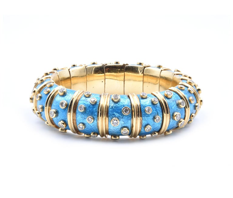 Designer: Tiffany & Co. Material: 18k yellow gold and blue Paillonne enamel Diamonds: 108 round brilliant cuts = 5.20cttw  Color: G Clarity: VS Dimensions: bracelet measures 18.50mm in width, will fit a 7-inch wrist Weight: 126.8 grams 646-639