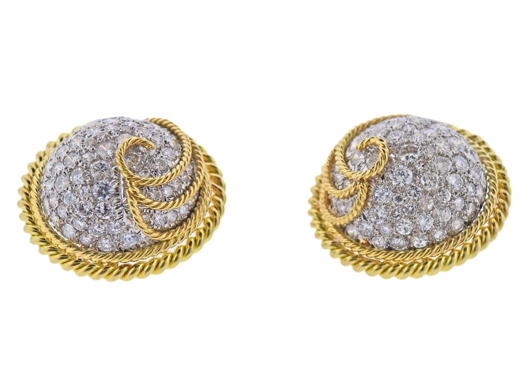Pair of 18k gold and platinum earrings by Jean Schlumberger for Tiffany & Co, set with approx. 6.00-6.50ctw in diamonds. Earrings are 26mm in diameter. Marked: 750, Tiffany & Co, Schlumbeger. Weight - 36 grams.