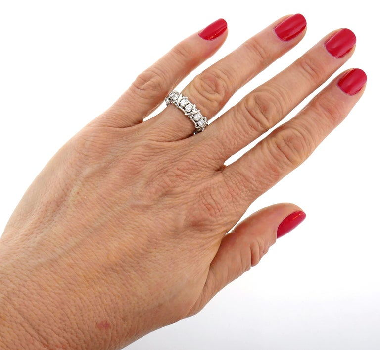 Timeless and elegant band ring created by Jean Schlumberger for Tiffany & Co. Classic design, perfect proportions. Elegant and timeless, the band is a great addition to your jewelry collection.  The ring is made of platinum and set with sixteen