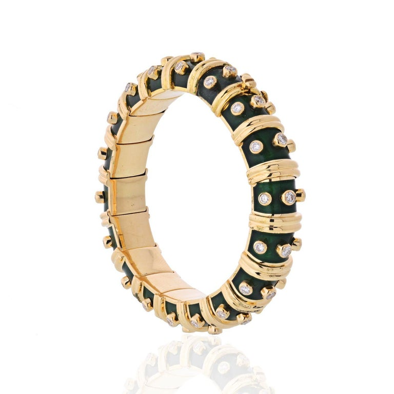 The bracelet features full-cut diamonds weighing a total of approximately 3.00 carats, enhanced by green enamel applied on 18k gold, marked Schlumberger Std., Tiffany & Co, French hallmark.  Width: 0.5 in  Inside circumference: 6.25 inches.