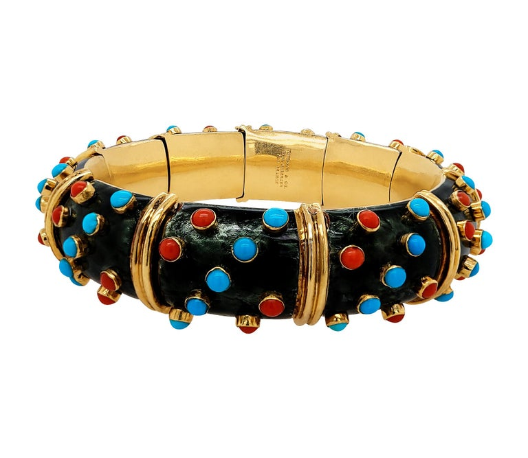 A beautiful vintage bracelet from the famous Schlumberger collection by Tiffany & Co.  It is embellished with turquoise, coral and black enamel which is a very rare combination. The metal is 18K yellow gold. Weight of the bracelet is 143.73